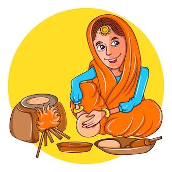 Mulher do punjabi que faz chapatis no fogão de terra.