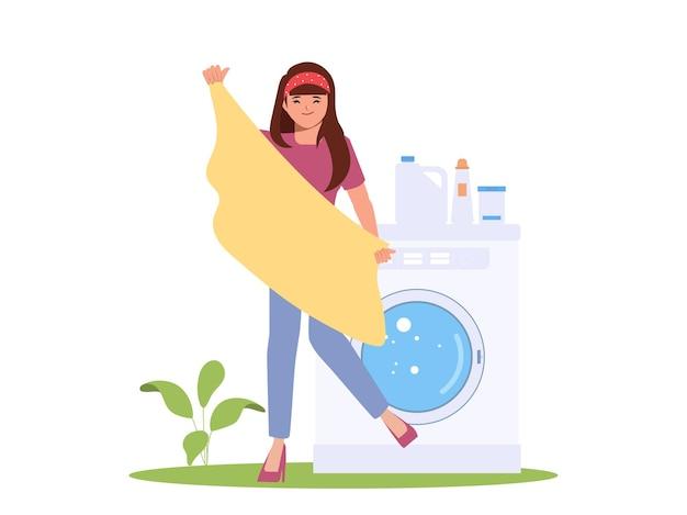 Mulher dona de casa limpando roupas com máquina de lavar roupa