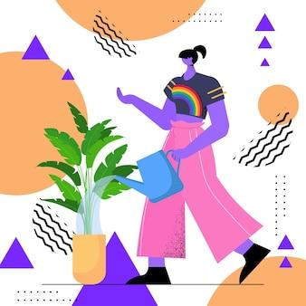 Mulher dona de casa regando plantas mulher vestindo camiseta lgbt arco-íris transgênero ama o conceito de trabalho doméstico