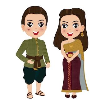 Mulher e homem em traje tradicional vestido tailandês.