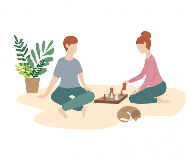 Mulher e homem jogam xadrez juntos.