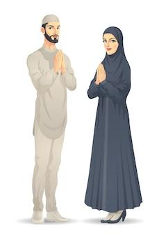 Mulher e homem muçulmano estão cumprimentando