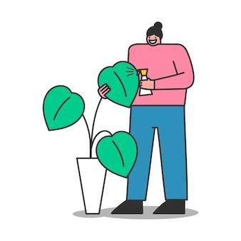Mulher e planta de casa. mulher dos desenhos animados cuidando da planta verde no pote. jardineira