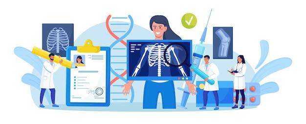 Mulher em pé atrás da máquina de raio-x para exame do tórax. diagnóstico médico de raios-x, exame do esqueleto ósseo. radiologia body scanner para diagnóstico de doenças do paciente. roentgen de osso do peito