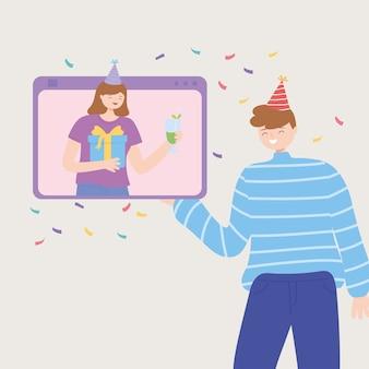 Mulher em videochamada com chapéu festivo comemorando online com homem