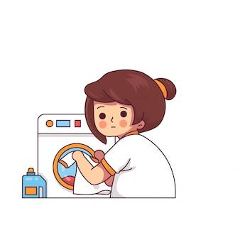 Mulher engraçada na lavanderia com máquina de lavar roupa