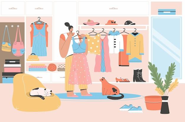 Mulher escolhe roupa em pé perto do guarda-roupa aberto