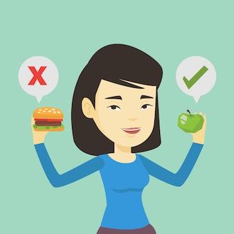 Mulher escolhendo entre hambúrguer e cupcake.