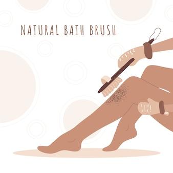 Mulher esfoliando as pernas com escova de madeira seca. cuidados com o corpo em casa. saúde da pele.