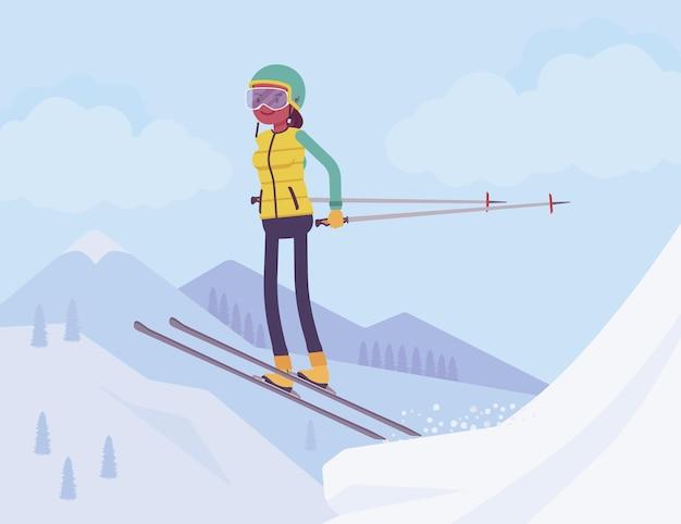 Mulher esportiva ativa esquiando, pulando e aproveitando a diversão ao ar livre de inverno no resort