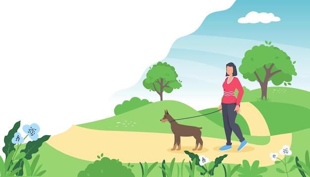 Mulher está caminhando com um cachorro.