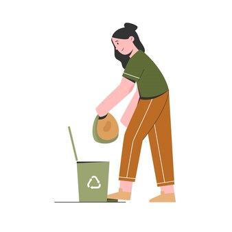 Mulher está levando o lixo para fora