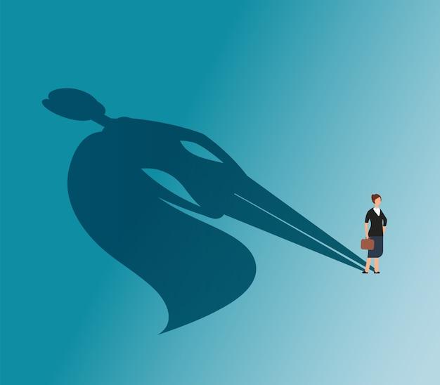 Mulher executiva com sombra de super-herói.