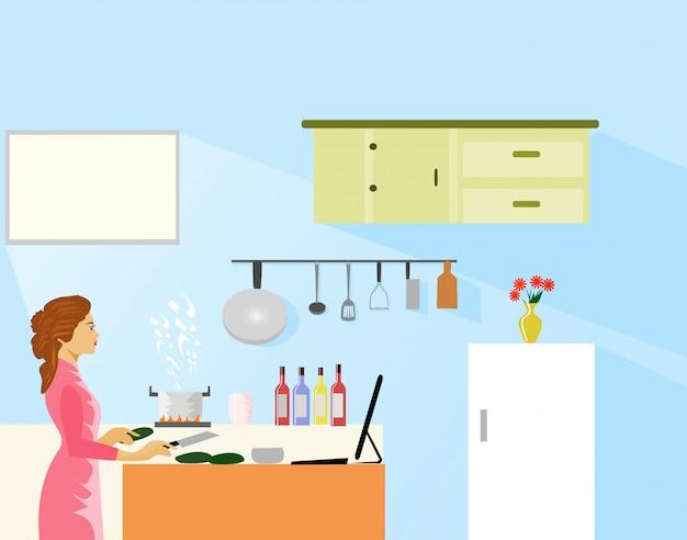 Mulher fazendo comida, olhando para métodos de cozimento na internet na cozinha.