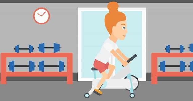 Mulher fazendo exercício de ciclismo.