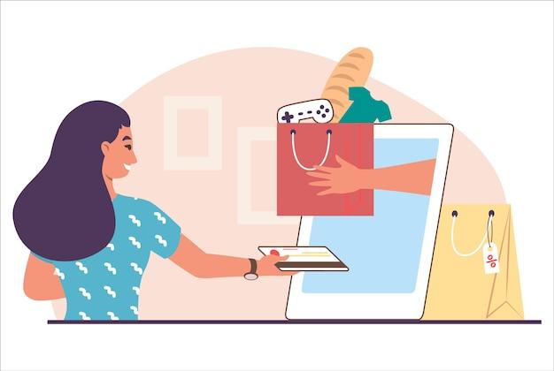Mulher fazendo pagamento online com cartão de crédito, ilustração vetorial plana. garota feliz comprando roupas, mantimentos e outros produtos na internet usando o telefone celular. e-commerce, loja online.