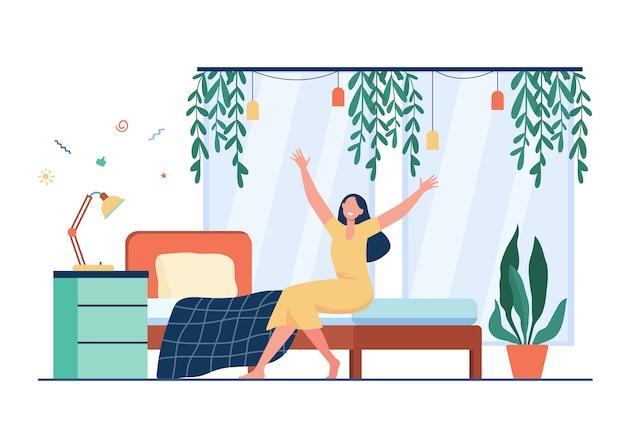 Mulher feliz acordando de manhã. pessoa sentada na cama e esticando os braços.