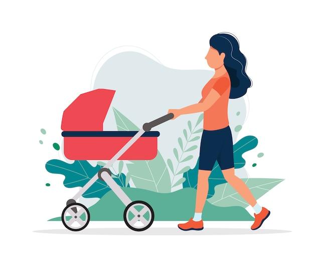 Mulher feliz com um carrinho de bebê no parque.