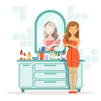 Mulher feliz penteando o cabelo uma frente do espelho