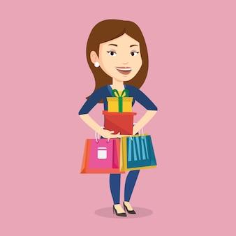 Mulher feliz segurando sacolas e caixas de presente.