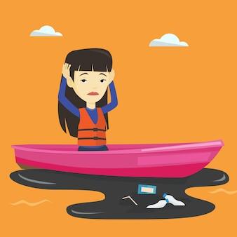 Mulher flutuando em um barco em água poluída.