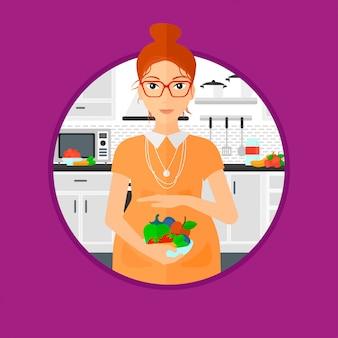 Mulher grávida com legumes e frutas.