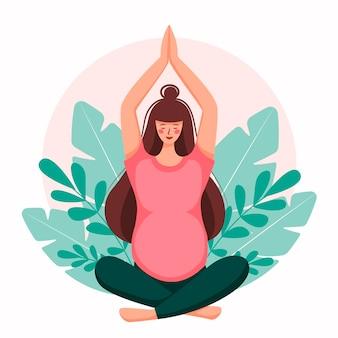 Mulher grávida medita.