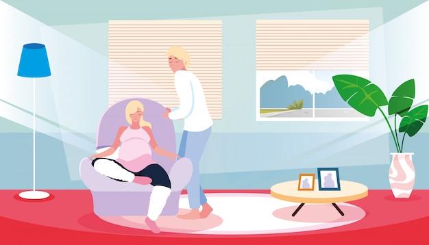 Mulher grávida sentada no sofá com o marido dentro de casa