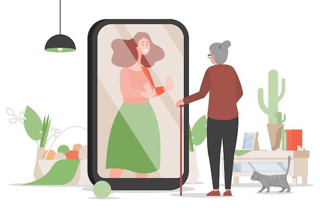 Mulher idosa em pé perto da tela do celular e conversando com a ilustração da filha
