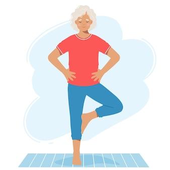 Mulher idosa madura realiza o exercício de pé no tapete