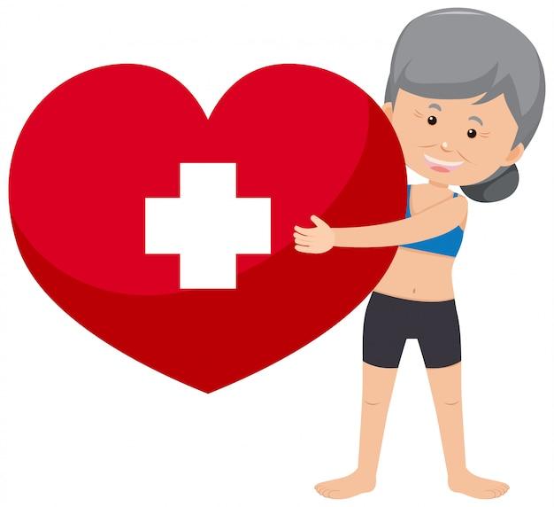 Mulher idosa segurando o símbolo do coração vermelho sobre fundo branco