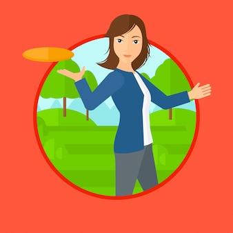 Mulher jogando disco voador.