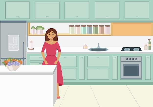 Mulher jovem com um vestido de framboesa em sua cozinha verde-clara