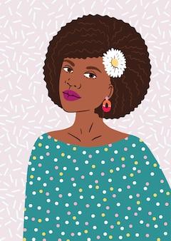 Mulher jovem e bonita afro-americana com penteado afro.