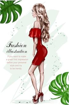 Mulher jovem e bonita com um vestido vermelho.