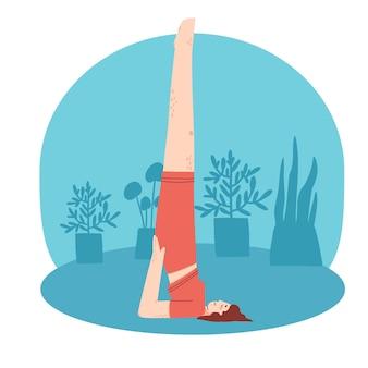 Mulher jovem fazendo exercícios de ioga em casa. fundo interior de quarto aconchegante com plantas caseiras