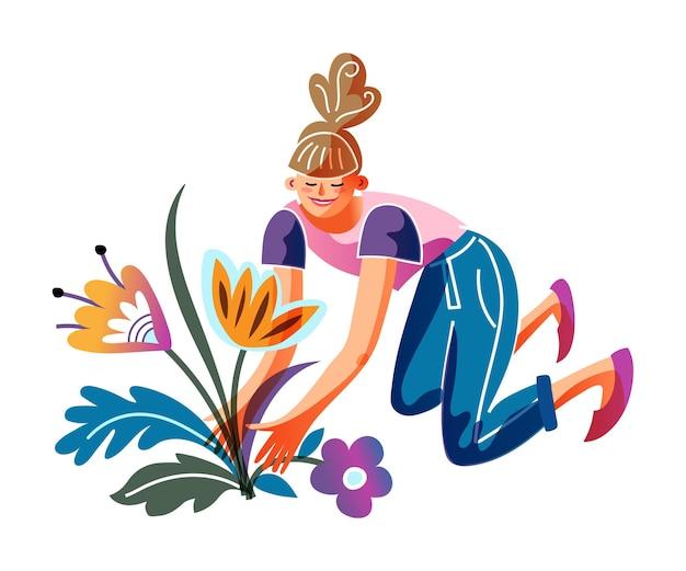 Mulher jovem plantando flores em canteiro