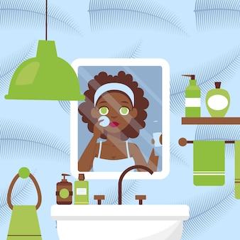 Mulher, limpeza, rosto, em, banheiro