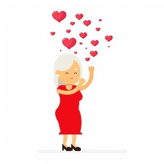 Mulher madura em um vestido vermelho jogando corações no ar