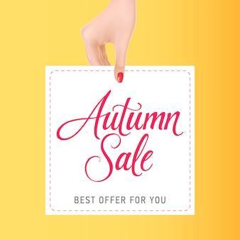 Mulher mão, segurando, cartão, com, outono, venda, lettering