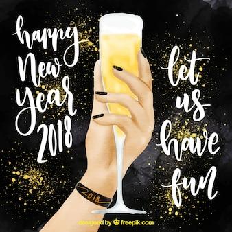 Mulher mão segurando uma taça de champanhe