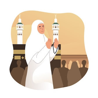 Mulher muçulmana rezando na frente da kaaba em meca