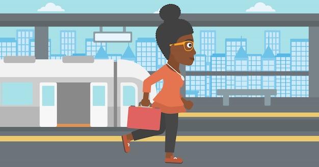 Mulher na ilustração do vetor da estação de trem.