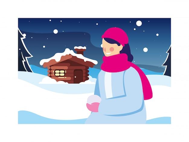 Mulher na paisagem de inverno e casa da família
