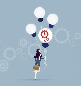 Mulher negócio, andar, com, quatro, voando, lâmpadas incandescentes