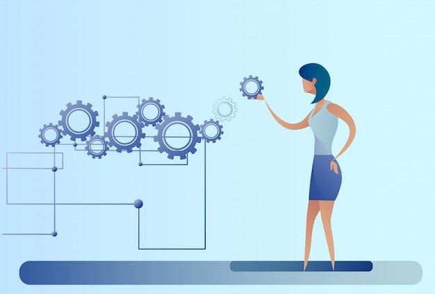 Mulher negócio, com, roda dentada, roda mulher negócios, brainstorming, processo