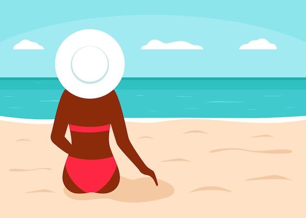 Mulher negra em maiô vermelho senta-se na praia e olha a vista de trás do mar. silhueta de menina africana