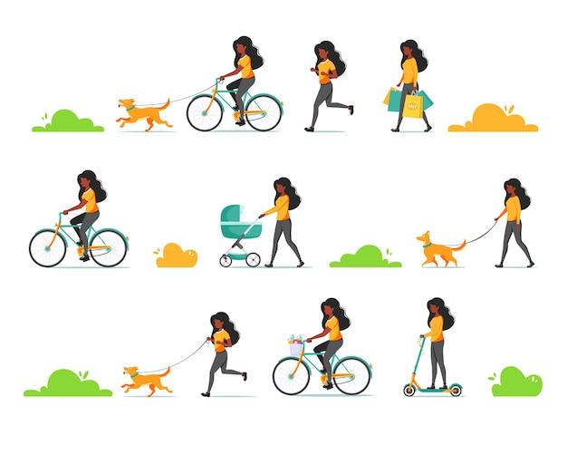 Mulher negra fazendo várias atividades ao ar livre passear com cachorro, criança, andar de bicicleta, scooter, correr