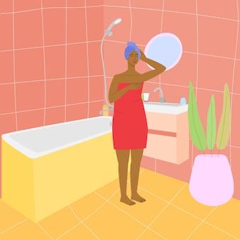 Mulher negra no banheiro garota em uma toalha no interior do banheiro