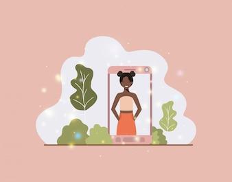 Mulher negra no smartphone na paisagem